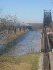 Crossing the Mississippi River: The shadow between the old and new captures the eye